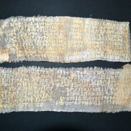 Verses inscribed on medical lint using a strand from a broom by Dr. Serafim Pâslaru in the infirmary where he worked as a prisoner